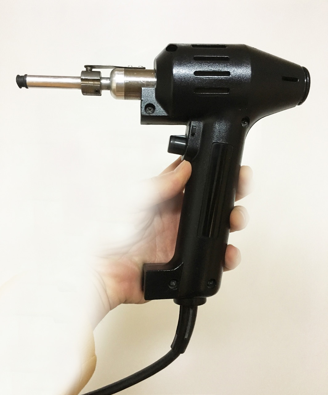 first hand held, electromechanical adjusting device